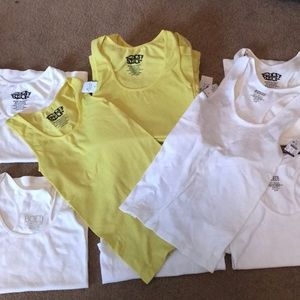 Tops - Twenty tank tops brand new with tags.